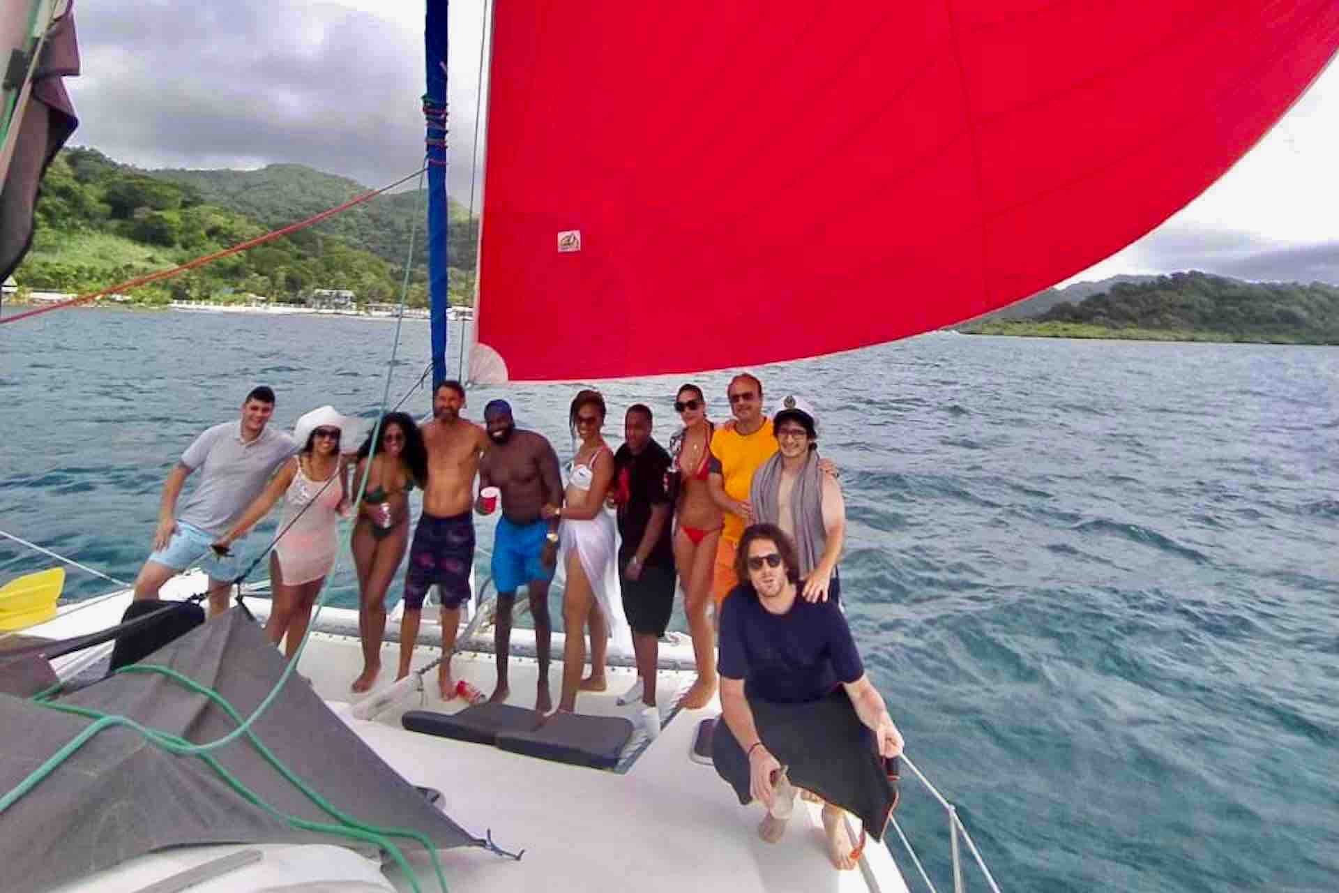 Panama Caribbean tour group photo with red sail