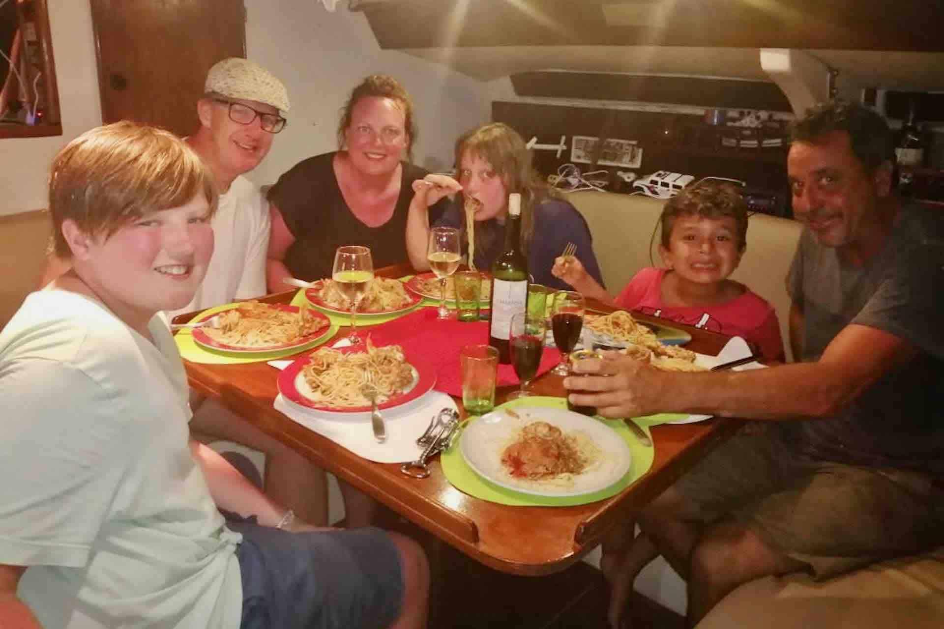 family diner on sailboat